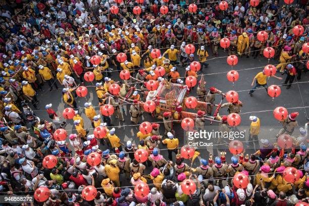 Pilgrims carry a sedan chair holding a statue of the goddess Mazu as they arrive at Houtian Temple on day three of the nine day Mazu pilgrimage on...