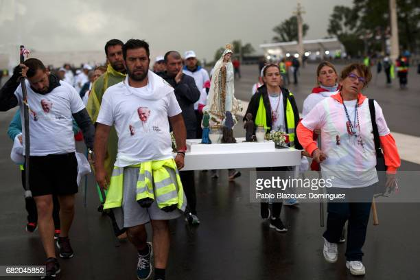 Pilgrims carry an image of the Virgin Mary as they arrive to the Sanctuary of Fatima on May 11, 2017 in Fatima, Portugal. Pope Francis will be...