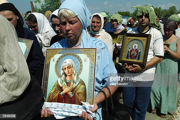 Pilgrims carry icons during their religious procession July 28 2003 on the road from Kursk to Diveyevo 375 km southeast of Moscow Russia The...