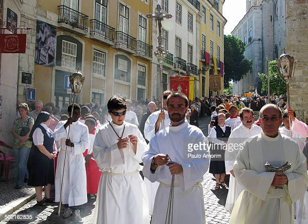 Pilgrims catholics walking at district of the Alfama in Lisbon,Portugal during the annual procession of the Saint Antonio. - Photo by Paulo Amorim
