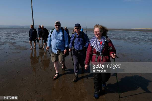 Pilgrims celebrate Easter by carrying wooden crosses as they walk over the tidal causeway to Lindisfarne during the final leg of their annual...