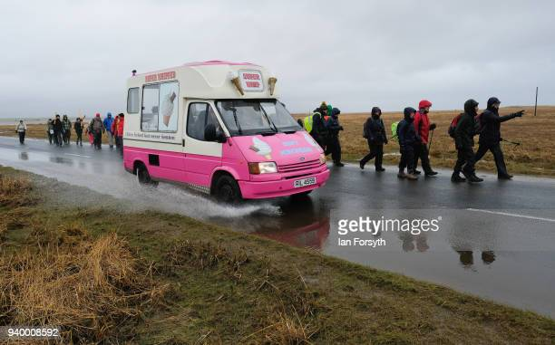 Pilgrims celebrate Easter by crossing over the tidal causeway carrying wooden crosses on the final leg of their annual pilgrimage to the Holy Island...