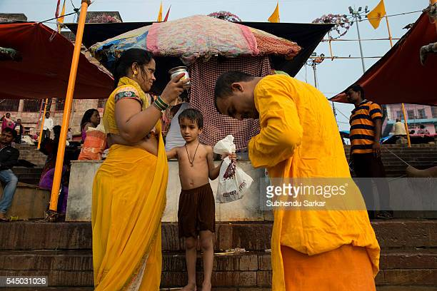 Pilgrims change clothes on the ghats after bathing in the waters of the river Ganges in Varanasi Varanasi is a holy town for the Hindus where...
