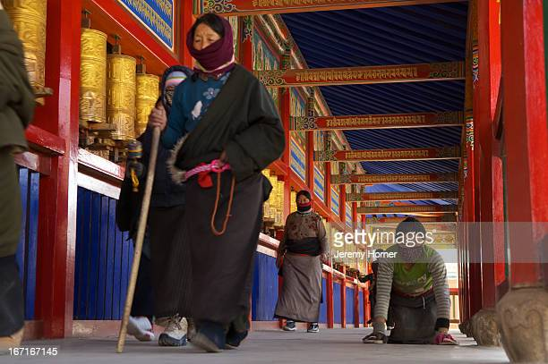 Pilgrims circumambulate the kora at Labrang Monastery during Tibetan New Year Gansu Province China Labrang Monastery is one of six monasteries of the...