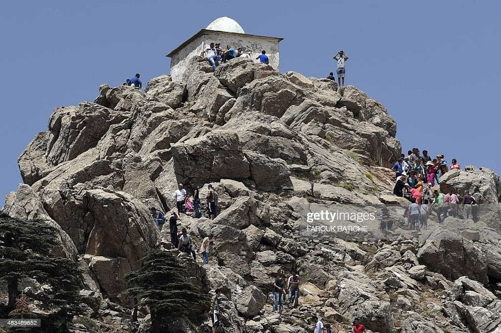 Pilgrims climb the Azro Nethor peak in the Djurdjura Mountain range, 1,884 meters above sea level, in Algeria's eastern Kabylia region on July 31, 2015, to reach 'el-Jammaa Oufella' (the upstairs mosque). Thousands of people climb the peak every year to perform prayers hoping 'the saints' will answer their pleas.
