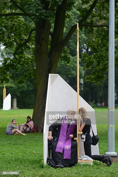 Pilgrims confess before the opening ceremony of the World Youth Days by Pope Francis at Blonia meadow on July 28 2016 in Krakow World Youth Day draws...