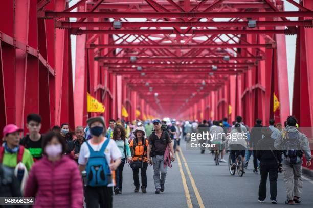 Pilgrims cross Xilou Bridge as they walk ahead of a sedan chair holding a statue of the goddess Mazu on day three of the nine day Mazu pilgrimage on...