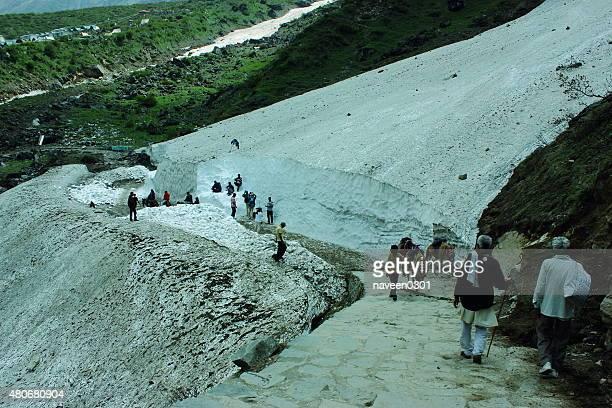pilgrims crossing a glacier on kedarnath trek in himalaya - uttarakhand stock pictures, royalty-free photos & images