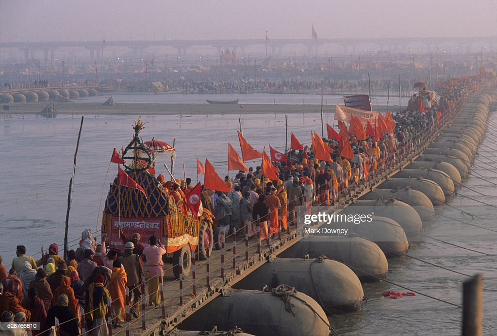 Pilgrims Crossing the Ganges River : Stock Photo
