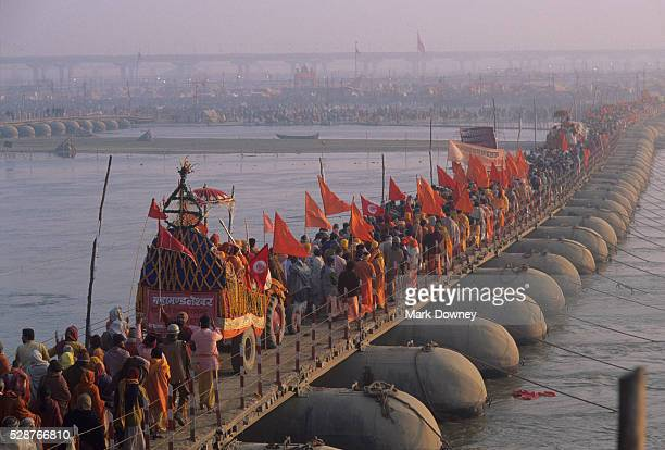 pilgrims crossing the ganges river - prayagraj stock pictures, royalty-free photos & images
