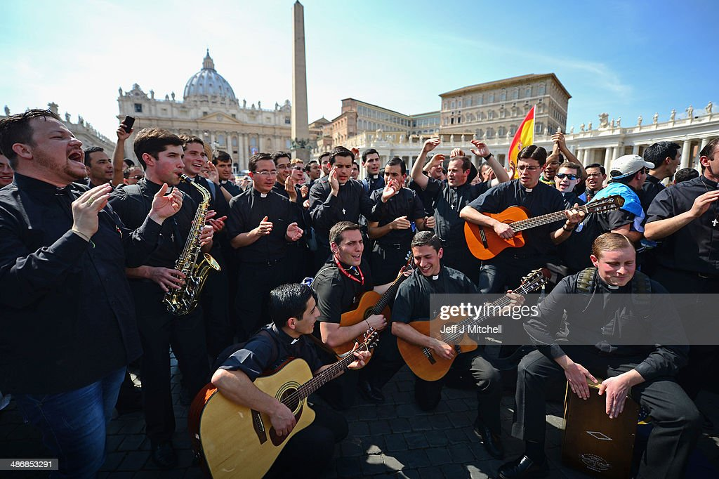 Pilgrims dance and pray as they wait to enter the Basilica in Saint Peter's Square on April 26, 2014 in Vatican City, Vatican. Dignitaries, heads of state and royalty from across the world gather at the Vatican for tomorrow's canonisations. The late Pope John Paul II and Pope John XXIII will be canonised on April 27th inside the Vatican with 800,000 pilgrims from around the world that are expected to attend.
