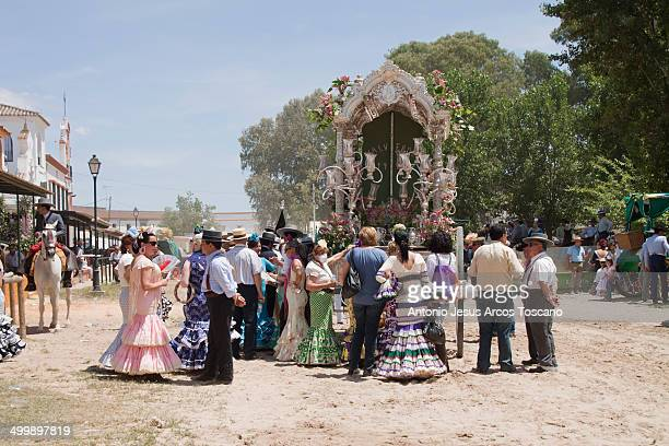 Pilgrims dressed in clothing of flamenco, waiting behind the simpecado Carreta of Valverde del Camino, for the procession and presentation in the...