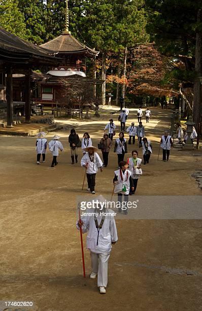 Pilgrims dressed in white approach the Danjo Garan Complex during an autumn pilgrimage