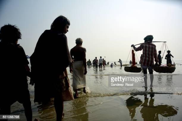 pilgrims during ganga sagar fair - ganga sagar stock photos and pictures