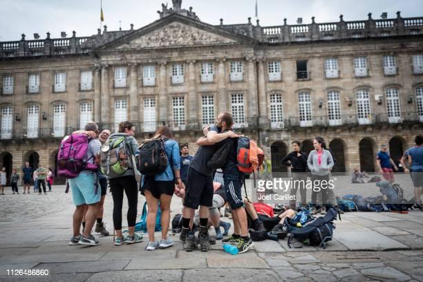 pilgrims embrace at end of the camino de santiago - santiago de compostela stock pictures, royalty-free photos & images