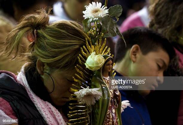 Pilgrims fall asleep at the Basilica of the Virgin of Guadalupe Mexico's Patron Saint during the annual celebrations on December 12 in Mexico City...