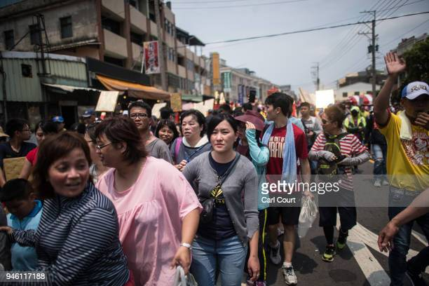 Pilgrims follow the sedan chair carrying a statue of the goddess Mazu on day two of the nine day Mazu pilgrimage on April 14 2018 in Dadu Taiwan The...