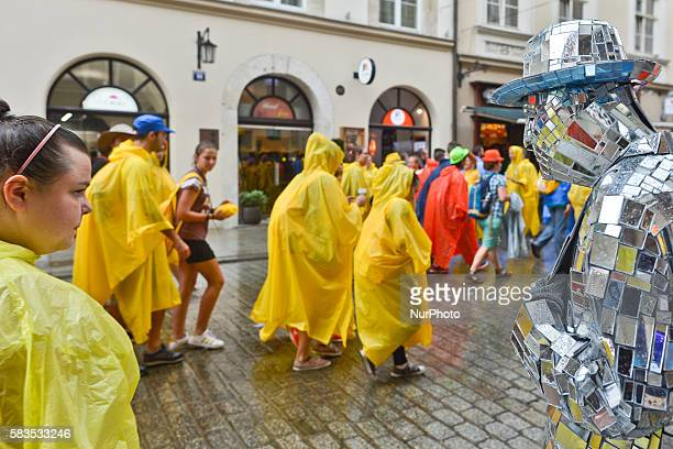 Pilgrims from all around the world surprised by a rain in the center of Krakow ahead of the official opening Mass and the World Youth Day 2016 in...