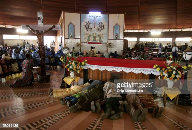 Pilgrims from Kenya Tanzania Sudan Rwanda and other African countries prostrate themselves in front of the tomb of of Charles Lwanga the leader of 26...