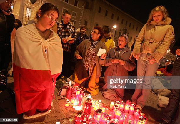 Pilgrims from Poland pray outside Saint Peter's Square just before midnight waiting for the funeral of Pope John Paul II April 7, 2005 in Rome,...