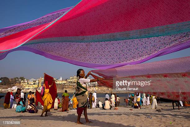 Pilgrims from Pune, Maharashtra drying Saris on the bank of the Holy Ganges.