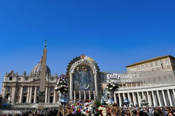Pilgrims from the Brotherhood of the Lord of the Miracles of Nazarenas of Cuzco Peru carrying an image of the Virgin Mary arrive at StPeter's square...
