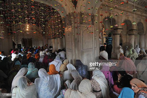 Pilgrims gather at a Sikh shrine in Lahore on June 29 on the 174th death anniversary of Maharaja Ranjit Singh Singh was also known as 'SherePunjab'...