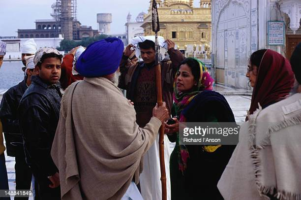 Pilgrims gather at the site of the holiest shrine for Sikhs, the Golden Temple (Harmandir Sahib) in Amritsar.