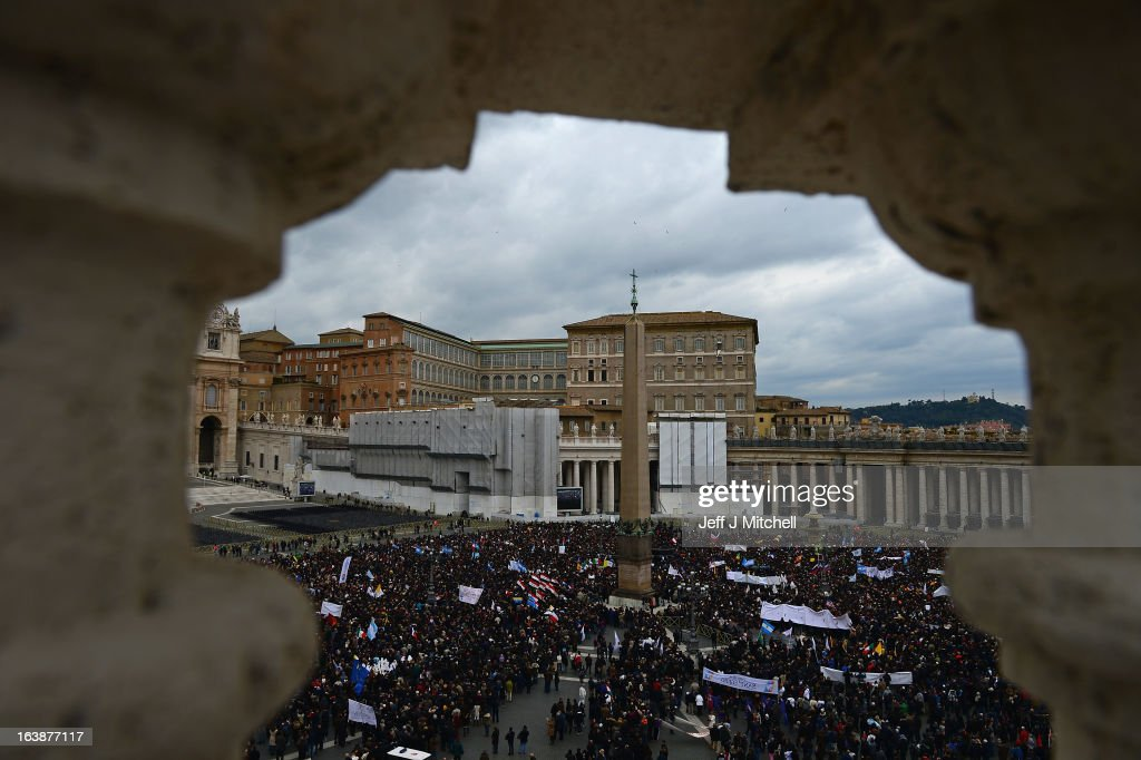 Pilgrims gather holding their country's flags as Pope Francis delivers his Angelus prayer and blessing to the thousands gathered in St Peter's Square on March 17, 2013 in Vatican City, Vatican.The Vatican is preparing for the inauguration of Pope Francis on March 19, 2013 in St Peter's Square.
