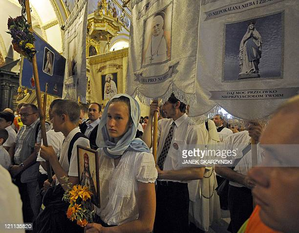 Pilgrims gather in the chapel of the Black Madonna shrine on August 14 in Czestochowa southern Poland For 300 years thousands of pilgrims from all...