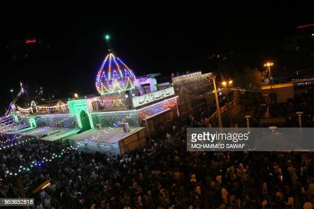 Pilgrims gather outside of the Imam alMahdi shrine during the Shaabaniya ceremony commemorating the Imam's birth the holiest figure for Shiite...