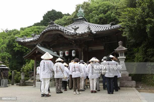 Pilgrims give worship at the temple No.64 'Maegamiji' on May 12, 2017 in Saijyo, Japan. The Shikoku Henro or Shikoku Pilgrimage is a 1200 km-long...