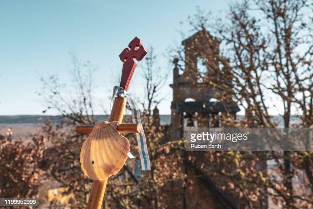 pilgrim's hiking pole with a shell and lebaniego way cross - camino de santiago stock pictures, royalty-free photos & images