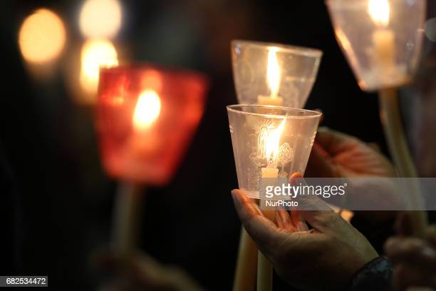 Pilgrims hold candles at the Apparitions Chapel before the traditional candle procession at Fatima's Sanctuary Leiria Portugal 12 May 2017 Pope...