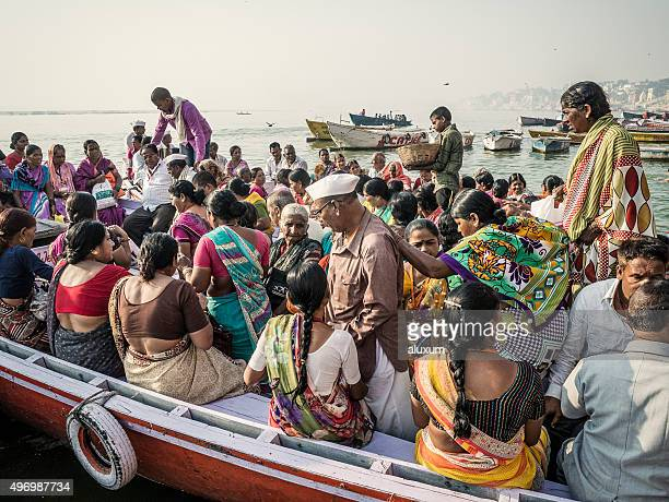 Pilgrims in a boat in Varanasi India