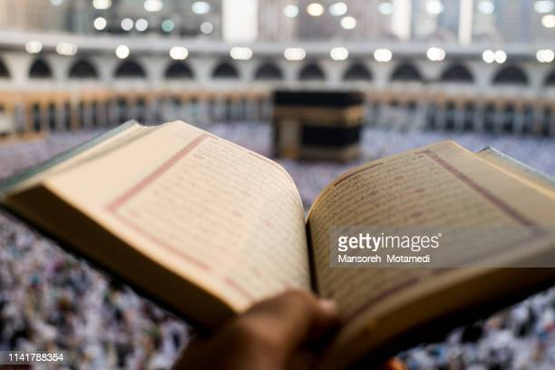 pilgrims in al-haram mosque - holy quran stock pictures, royalty-free photos & images