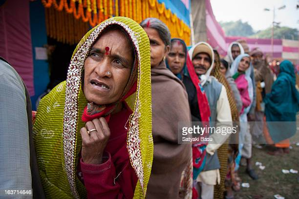 CONTENT] pilgrims in gangasagar transit camp waiting in ques for their turn to get free breakfast in maidan kolkata Gangasagar pilgrimage and fair is...