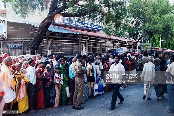 Pilgrims in the courtyard of a temple Tirumala Venkateswara Temple Tirumala Tirupati Chittoor District Andhra Pradesh India