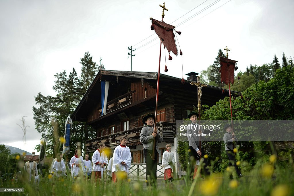 Pilgrims in traditional Bavarian folk dress walk to attend the annual Ascension Mass (in German called Christi Himmelfahrt) at the open-air altar at Birkenstein on May 14, 2015 near Fischbachau, Germany. Several thousand pilgrims from 40 different folk group associations participated in the annual event to mark Jesus Christ's ascension to Heaven in a tradition going back centuries. Bavaria is predominantly Catholic.