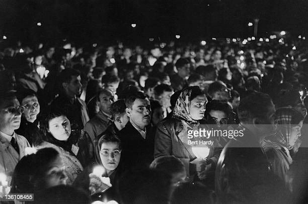 Pilgrims make their way to Fatima in Portugal to see the site where The Virgin Mary was said to have appeared in 1917 May 1952 Here the torchlit...