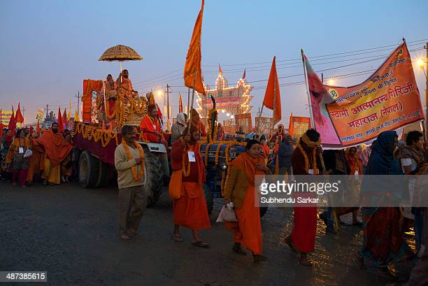 Pilgrims march towards the confluence of the Ganges and Yamuna rivers to take a holy dip in the early morning during Maha Kumbh mela. Kumbh Mela is a...