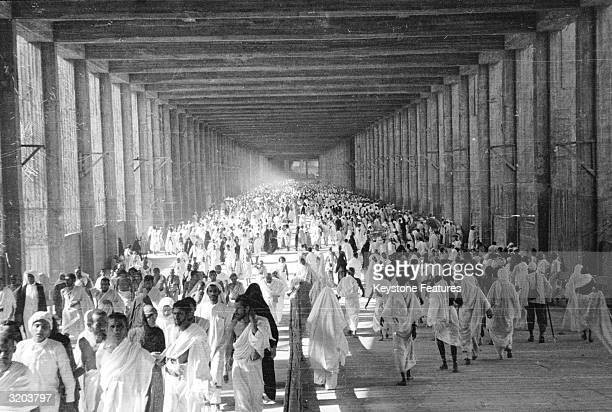 Pilgrims marching between the eminences of Safa and Marwa at the Mosque of Mecca in Saudi Arabia