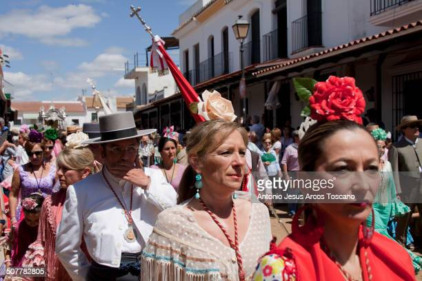 Pilgrims of the Brotherhood of El Rocío from Moguer procession through the streets of the village, accompanying their Brotherhood, dressed in...