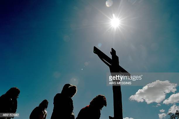Pilgrims of the Greek Orthodox Church stand in front of an image of Jesus crucified during the ceremony marking the Apokathelosis the removal of...