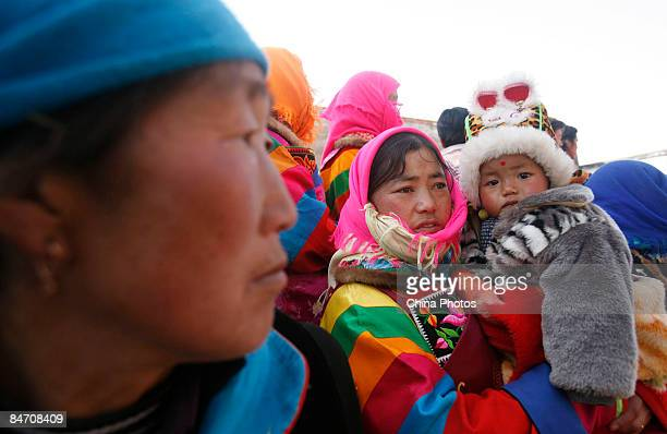 Pilgrims of Tu ethnic minority group attend the 'Tiaoqian' praying ceremony at the Youning Temple on February 8 2009 in Huzhu County of Qinghai...