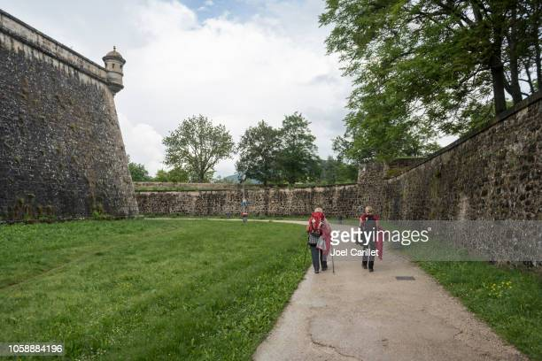 pilgrims on camino de santiago arriving in pamplona, spain - pamplona stock pictures, royalty-free photos & images