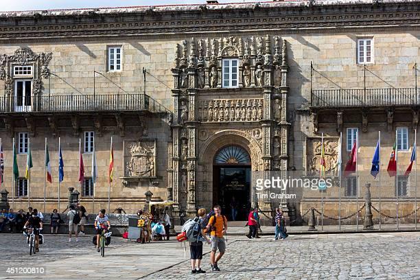 Pilgrims on Camino de Santiago pilgrim trail passing Parador Hostal de los Reyes Catolicos in Santiago de Compostela Galicia Spain#13#10