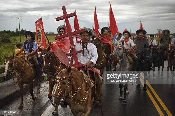 Pilgrims on horseback head to the sanctuary of folk saint Gauchito Gil near Mercedes in the Argentine province of Corrientes on January 8 2017 The...