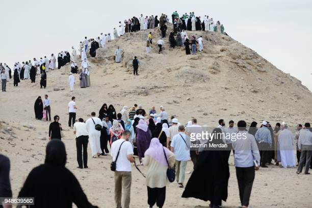 pilgrims on streets during hajj in saudi arabia - hajj stock photos and pictures