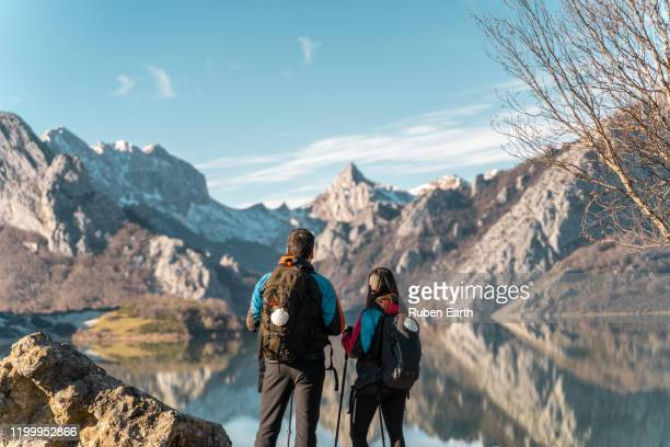 pilgrims on the way to santiago looking at the mountains landscape - camino de santiago stock pictures, royalty-free photos & images